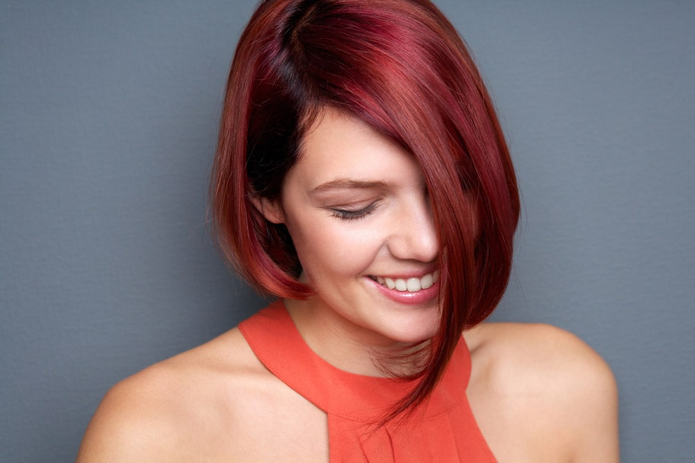 model with dyed red hair and asymmetrical haircut