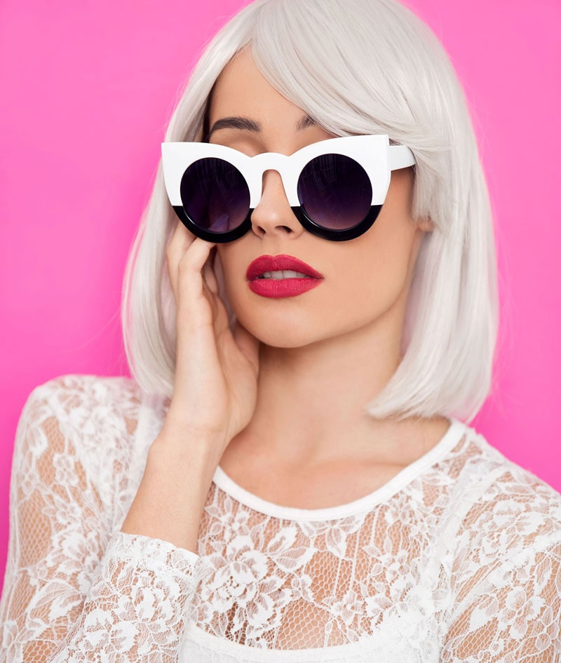 model with platinum blond blunt cut bob hairstyle wearing decorative sunglasses