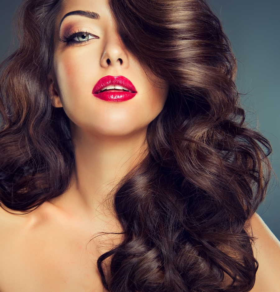 brunette model with darker lowlights in hair
