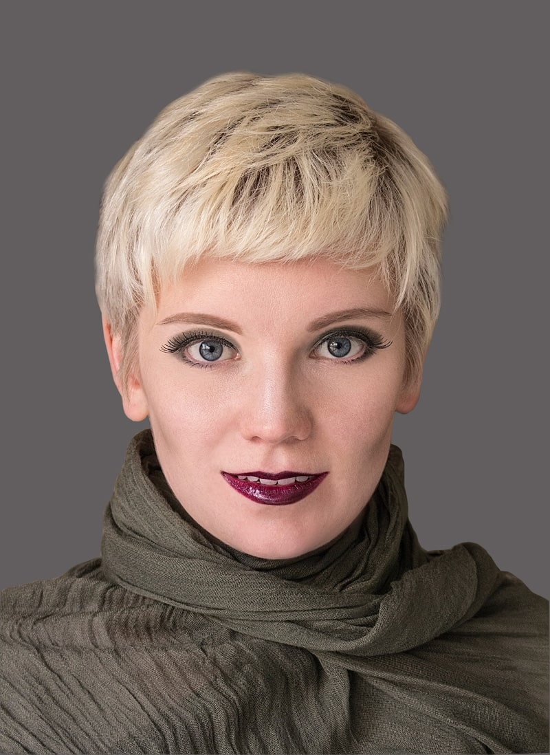 model with blond pixie cut and short bangs