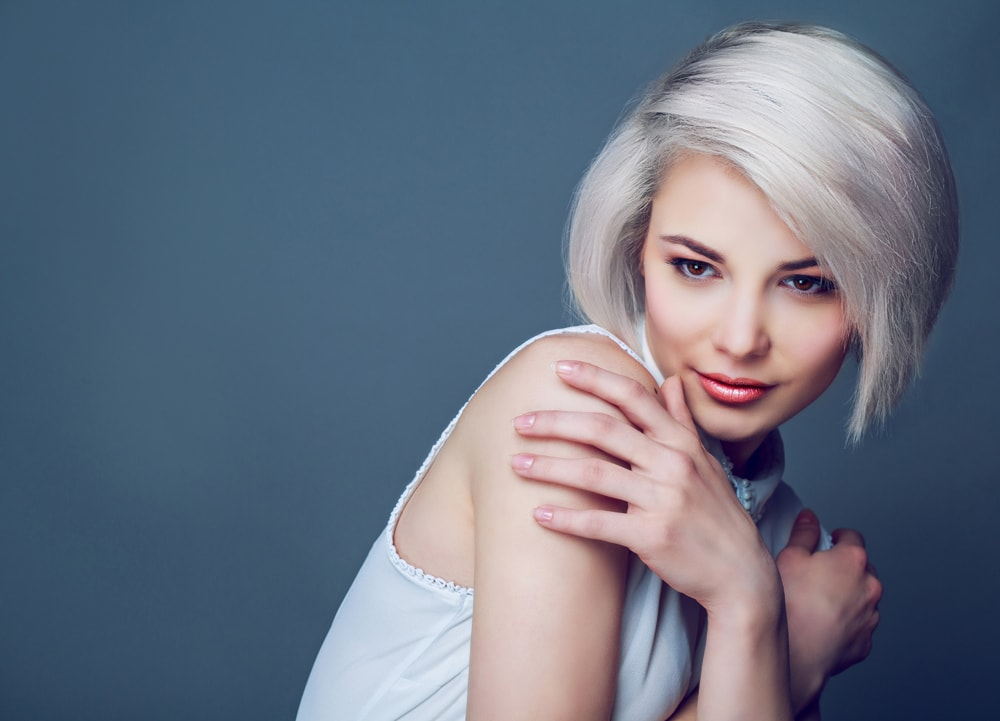 woman with short platinum blonde hair