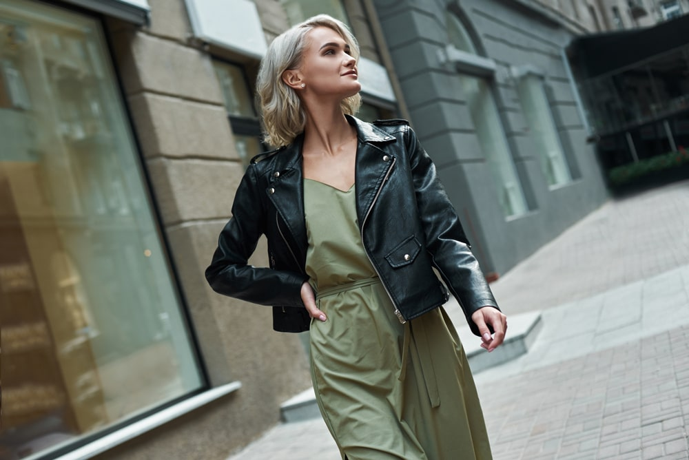 model walking on sidewalk with lob haircut