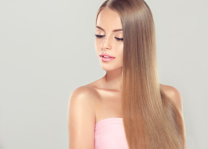 model with long light brown straight hair