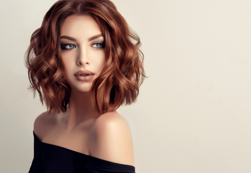 girl with short wavy red hair