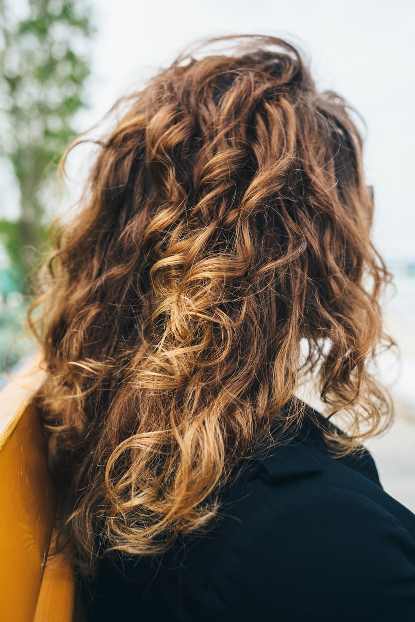 long curly blonde highlighted hair