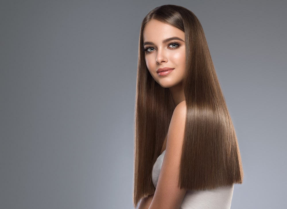 model with one length long brown hair